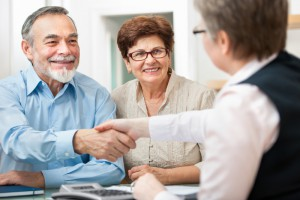 Attorney-consulting-with-retired-couple